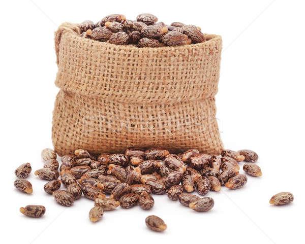 Castor beans in jute sack Stock photo © bdspn