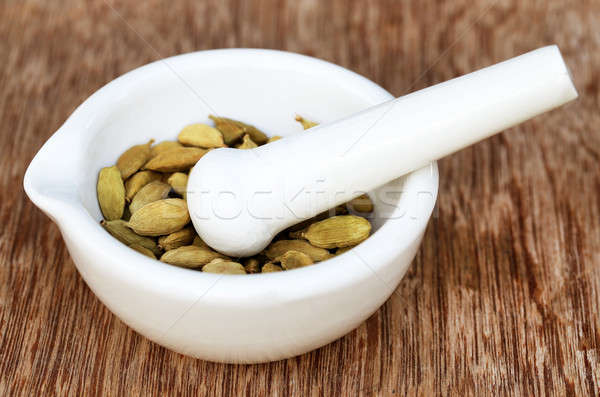 Cardamom seeds in a mortar Stock photo © bdspn