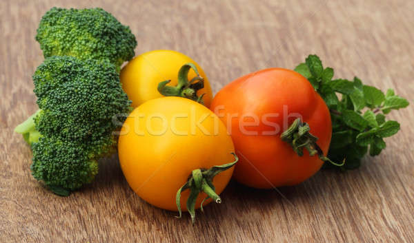 Ripe tomato with mint leaves and broccoli Stock photo © bdspn