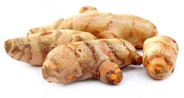 Raw Turmeric over white background Stock photo © bdspn