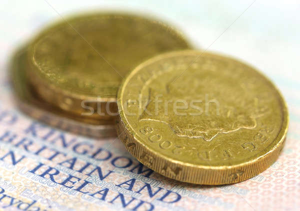 British Pound coin on a passport Stock photo © bdspn