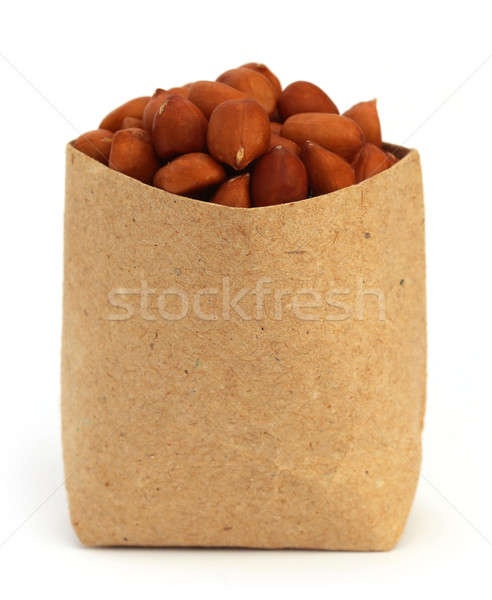 Stock photo: Peanut in a paper pack