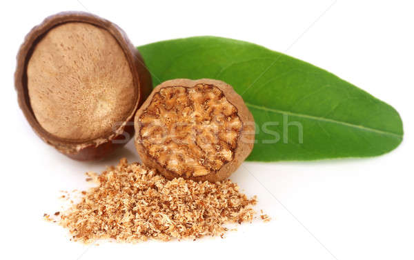 Nutmeg with green leaves Stock photo © bdspn