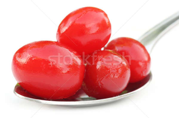 Processed cherry on a silver spoon Stock photo © bdspn