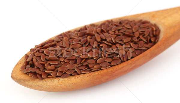 Flax seeds in wooden spoon Stock photo © bdspn