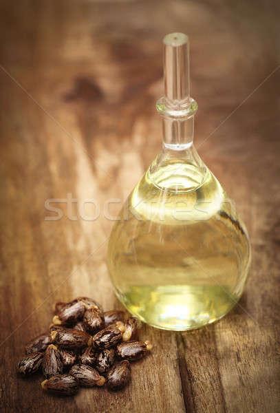 Castor beans and oil Stock photo © bdspn