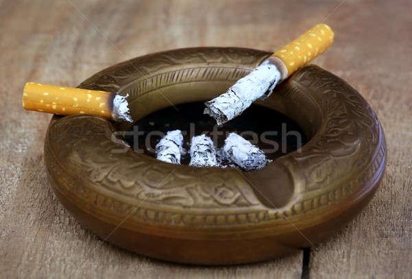 Yanan sigara eski küllük iki Stok fotoğraf © bdspn
