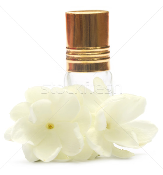 Jasmine flower with perfume bottle Stock photo © bdspn
