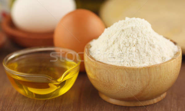Flour with eggs and cooking oil Stock photo © bdspn