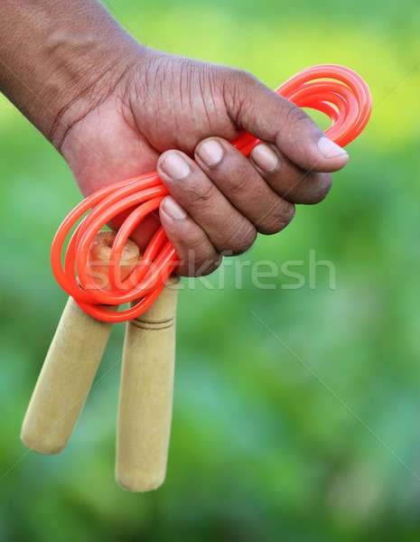 Skipping rope in hand Stock photo © bdspn