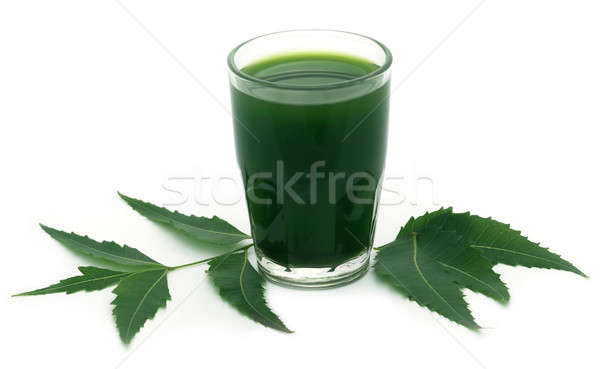 Medicinal neem leaves with extract Stock photo © bdspn