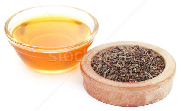 Stock photo: Caraway seeds with essential oil in glass bowl
