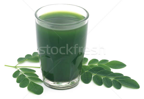 Moringa leaves with extract in a glass Stock photo © bdspn