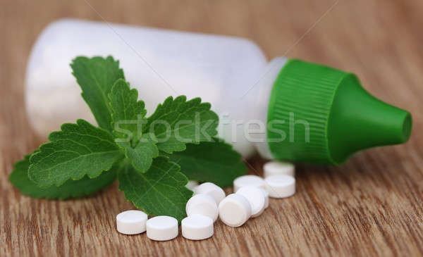 Stevia with sweetening tablets and bottle Stock photo © bdspn