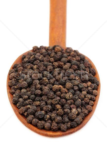 Negro pimientos cuchara de madera blanco alimentos cocina Foto stock © bdspn