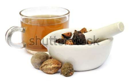 Triphala, a combination of ayurvedic fruits with mortar and pest Stock photo © bdspn