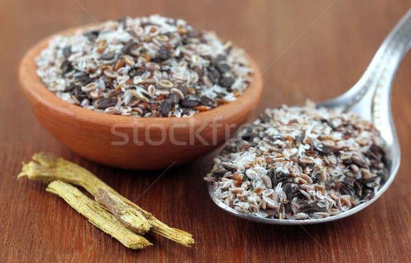 Medicinal herbs on a wooden surface Stock photo © bdspn