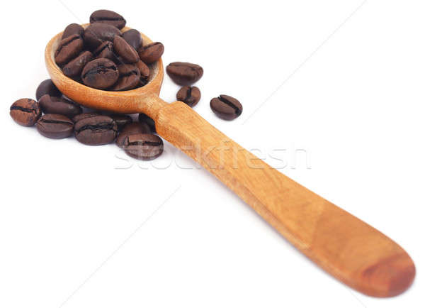 Roasted coffee beans in wooden spoon Stock photo © bdspn