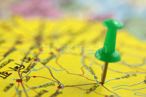 Pushpin pointing place on map Stock photo © bdspn