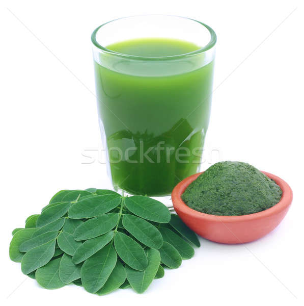 Moringa leaves with extract in Stock photo © bdspn