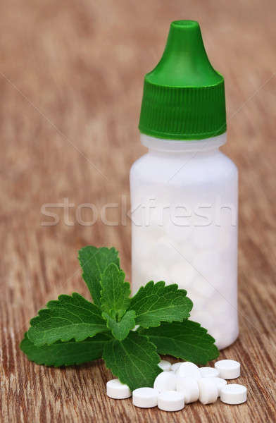 Stevia with sweetening tablets Stock photo © bdspn
