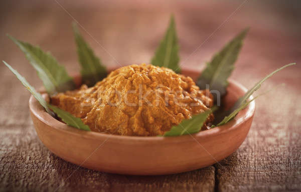 Medicinal turmeric paste with neem leaves Stock photo © bdspn
