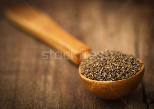 Ajwain seeds in a wooden spoon Stock photo © bdspn