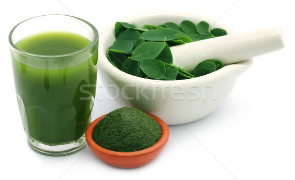 Mashed moringa leaves with extract in a glass Stock photo © bdspn