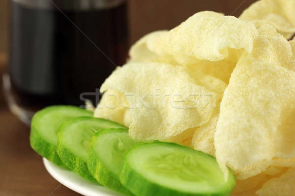 Potato chips with sliced cucumber Stock photo © bdspn
