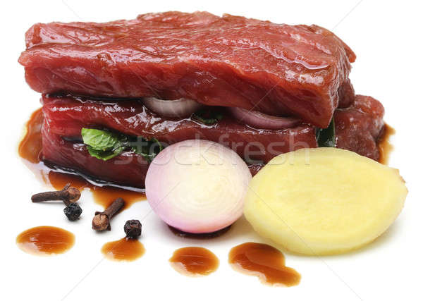 Raw beef with spices and soya sauce Stock photo © bdspn
