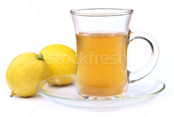 Cup of tea with whole lemon Stock photo © bdspn