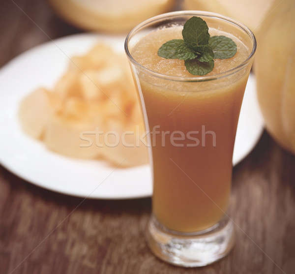 Muskmelon on a plate and juice Stock photo © bdspn