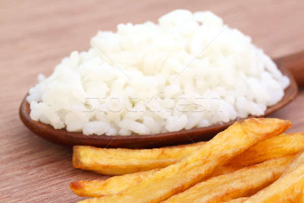 French fry with fresh rice over brown background Stock photo © bdspn