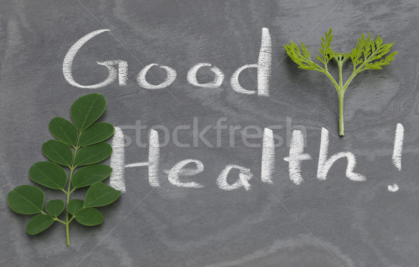 Moringa leaves with Good Health written in a slate Stock photo © bdspn