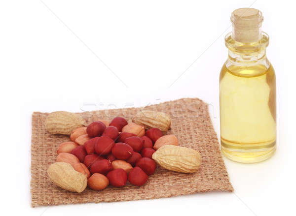 Fresh Peanuts with cooking oil Stock photo © bdspn