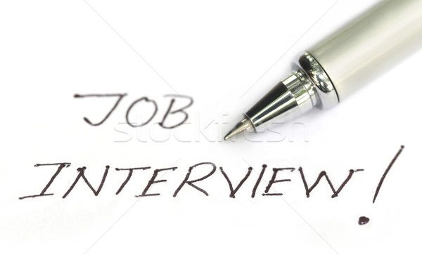 Job Interview written on a white paper Stock photo © bdspn