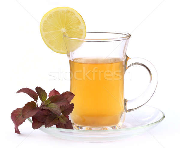 Cup of herbal tea with red tulsi leaves and lemon  Stock photo © bdspn