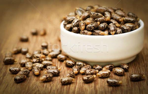 Castor beans in a ceramic bowl  Stock photo © bdspn