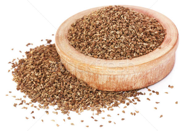 Ajwain seeds in a wooden bowl over white background Stock photo © bdspn