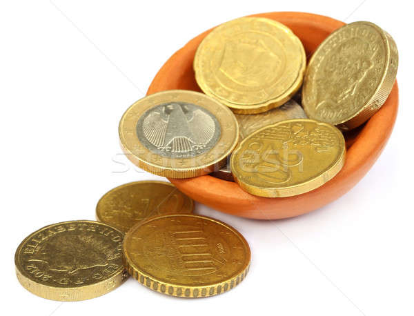 British Pound and euro coin Stock photo © bdspn