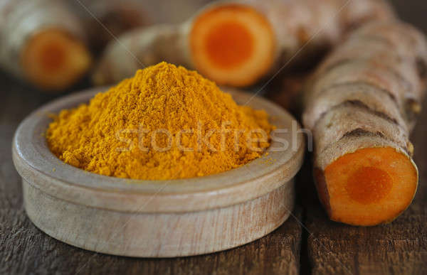 Raw and ground turmeric Stock photo © bdspn