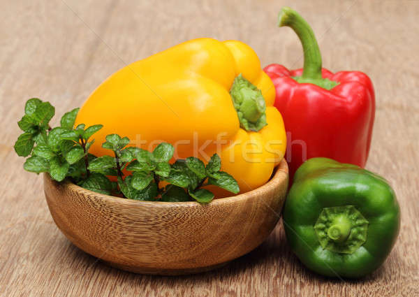 Capsicum with mint leaves on a bowl Stock photo © bdspn