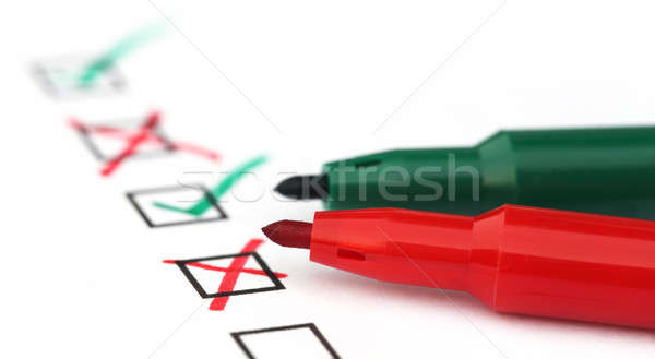 Stock photo: Check list with green and red pen