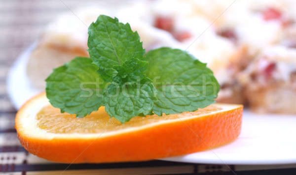 Pizza with mint leaves and orange Stock photo © bdspn