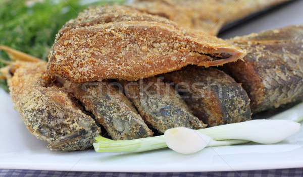 Closeup of uncooked preserved Ilish fish with vegetables Stock photo © bdspn
