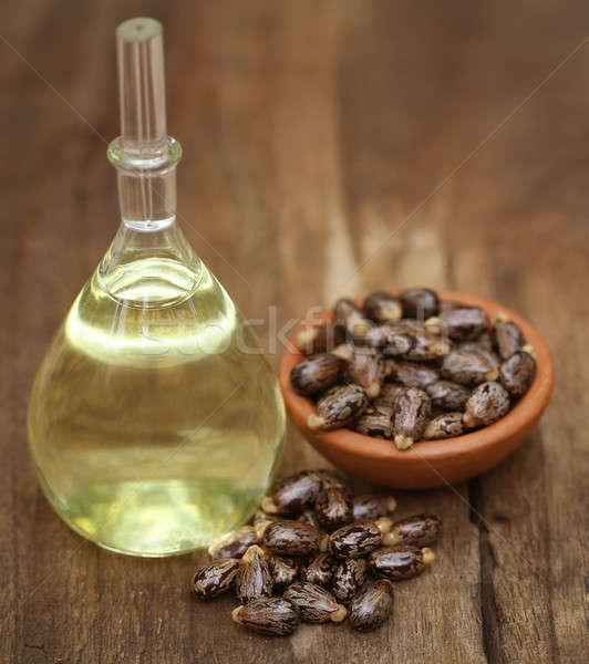 Castor oil with beans Stock photo © bdspn