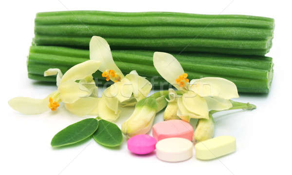 Moringa pills with flower and leaves Stock photo © bdspn