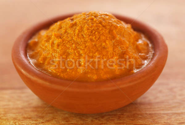 Raw turmeric paste in a bowl Stock photo © bdspn