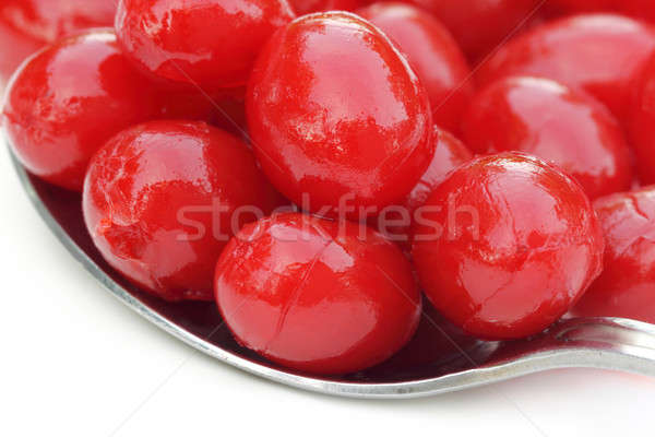 Processed cherry with a silver spoon Stock photo © bdspn
