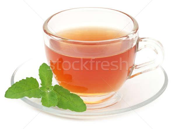 Chá medicinal copo folhas branco vidro fundo Foto stock © bdspn